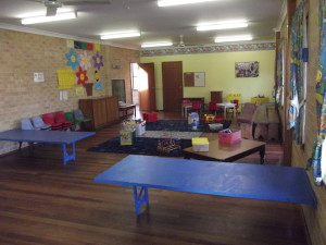 Playtime Room with fenced in grass play area